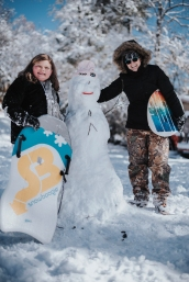 """Cammy and Mama with the snow woman. They named her """"Chilly""""."""