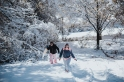 Me and my Aunt Fay walking up the hill to sled.